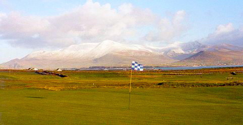 Golf under a snow covered Mount Brandon